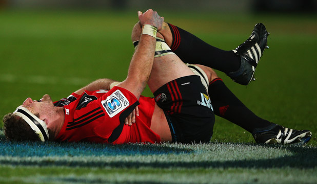 Kieran Read writhes in pain after hurting his ribs as the Crusaders beat  the Chiefs on July 6.
