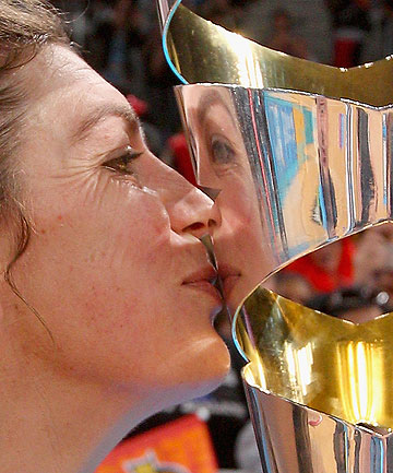 TRIUMPHANT: Irene van Dyk finally gets her hands, and lips, on the trophy.