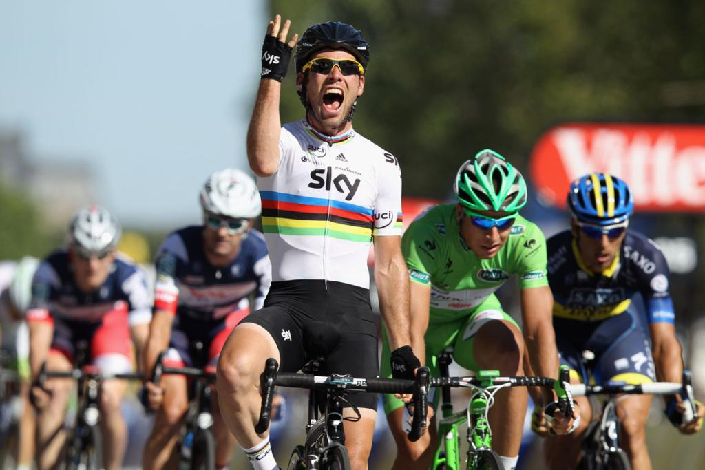 Mark Cavendish celebrates as he crosses the finish line to win the bunch sprint during the twentieth and final stage.