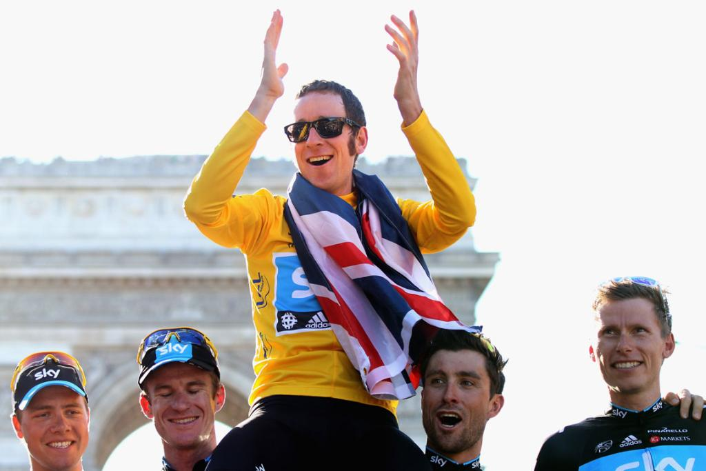 Bradley Wiggins is hoisted up by teammates as he celebrates his Tour de France victory.