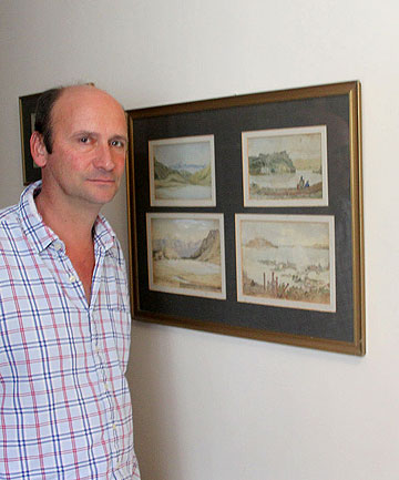 RARITIES: Sir Frederick Weld's great-great-great-grandson with some of the 19th-century watercolours.