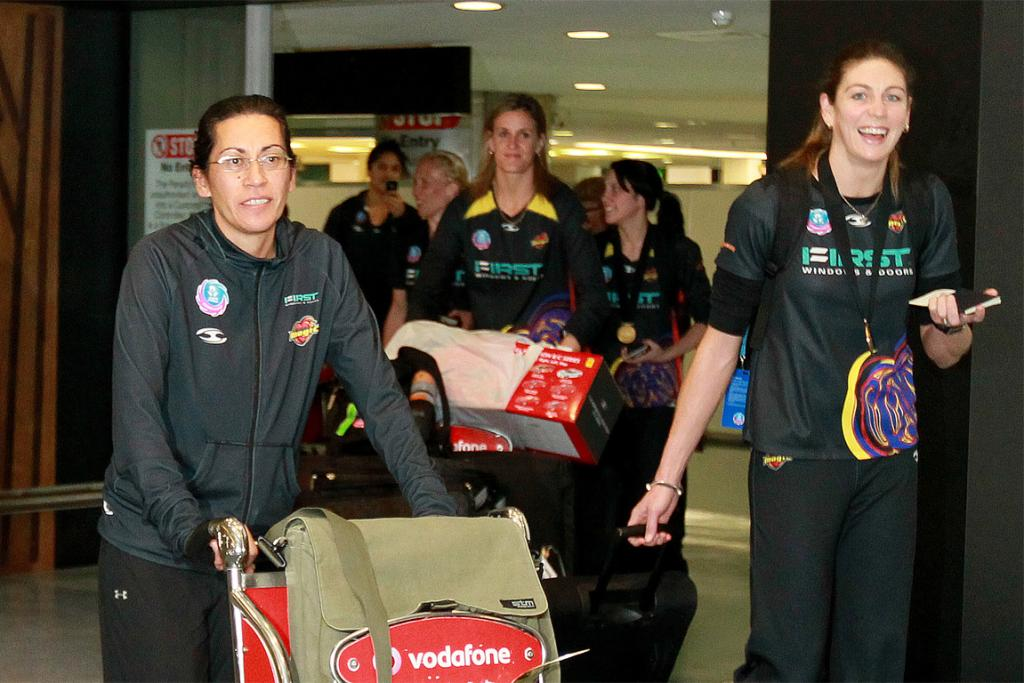 Coach Noelene Taurua (left), goal shoot Irene van Dyk (right) and the rest of the Magic arrive at Auckland Airport.