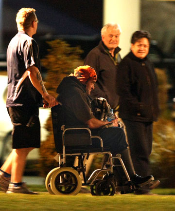 One of the men rescued men the overturned Sharcaree being wheeled into Southland Hospital last night.