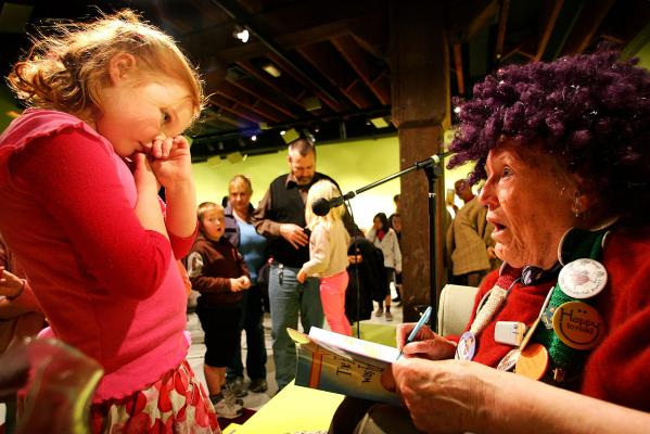 Eloise Cook gets a book signed by Margaret Mahy in 2010.