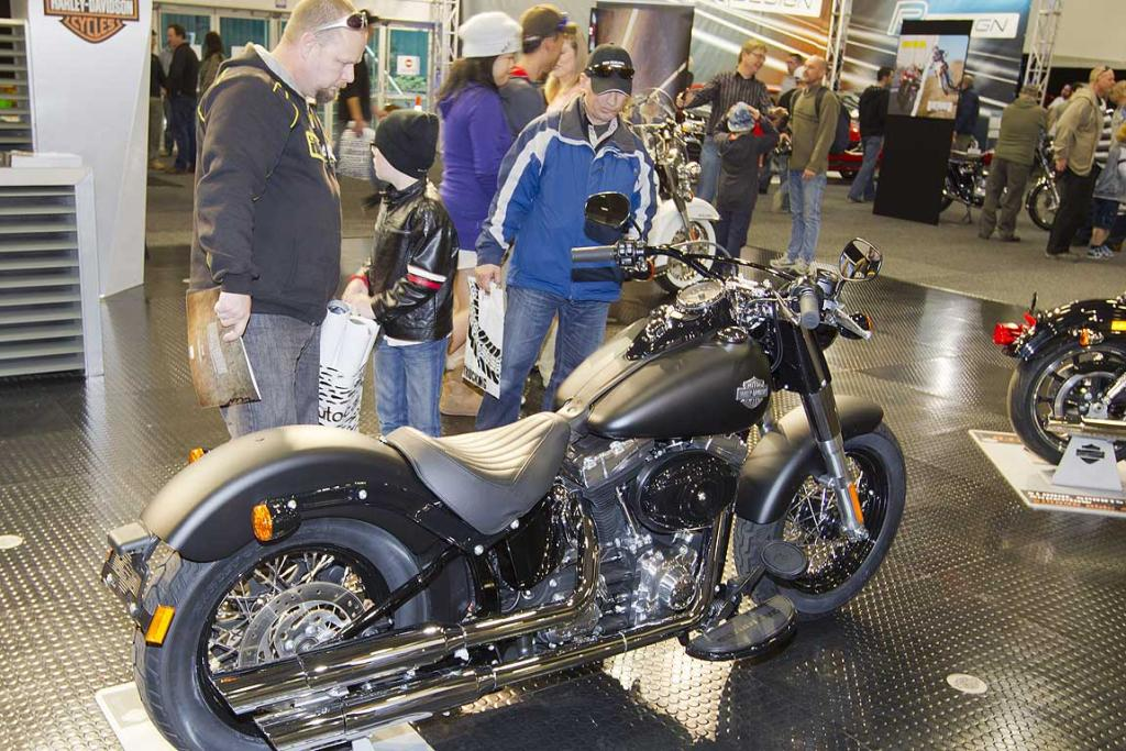 A Harley Davidson FLS Softail is admired at the CRC Speedshow.