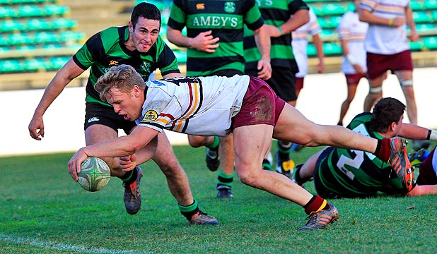 HE'S MADE IT: New Turbo Matenga Baker dives over for one of his three tries for College Old Boys on Saturday.