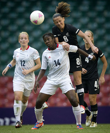 CHALLENGING: Football Fern Hayley Moorwood in action against Great Britain.