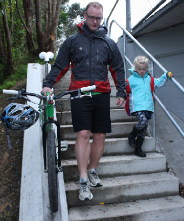 In use: Paul Carlyon escorts his daughter Macy to Waitohu School yesterday morning, using the new underpass.