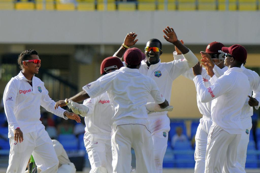 West Indies captain Darren Sammy celebrates with the team another New Zealand wicket.