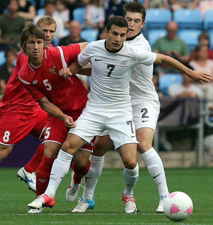 Belarus's Dmitry Baga and New Zealand's Kosta Barbarouses battle for the ball during NZ's loss to Belarus at the London Olympics.