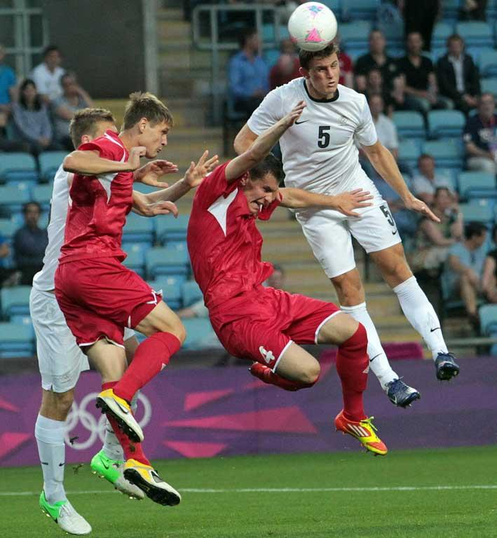 New Zealand's Tommy Smith heads the ball during the side's loss to Belarus at the London Olympics.