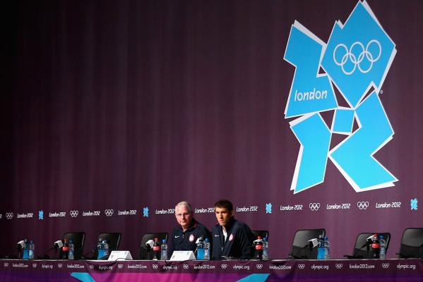Michael Phelps (right) and his coach Bob Bowman attend a press conference at the London Olympics.