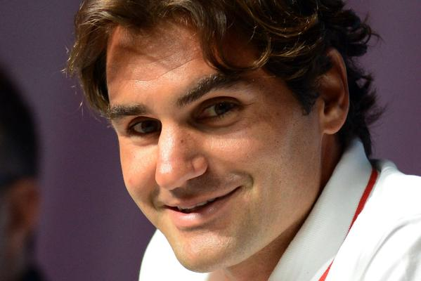 Roger Federer talks to the media at a press conference ahead of the men's tennis event at the London Olympics.