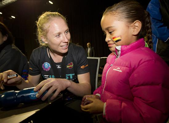 BIGGEST LITTLE FAN: Huni Te Koi, 6, with one of her netball heroes, Waikato Bay of Plenty Magic captain Laura Langman, at yesterday's champion's reception.