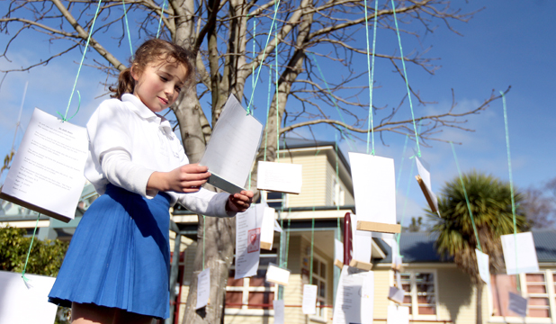 SPECIAL TREE: Scarlett Rumble, 8, of Ilam School, reads a poem during National Poetry Day.