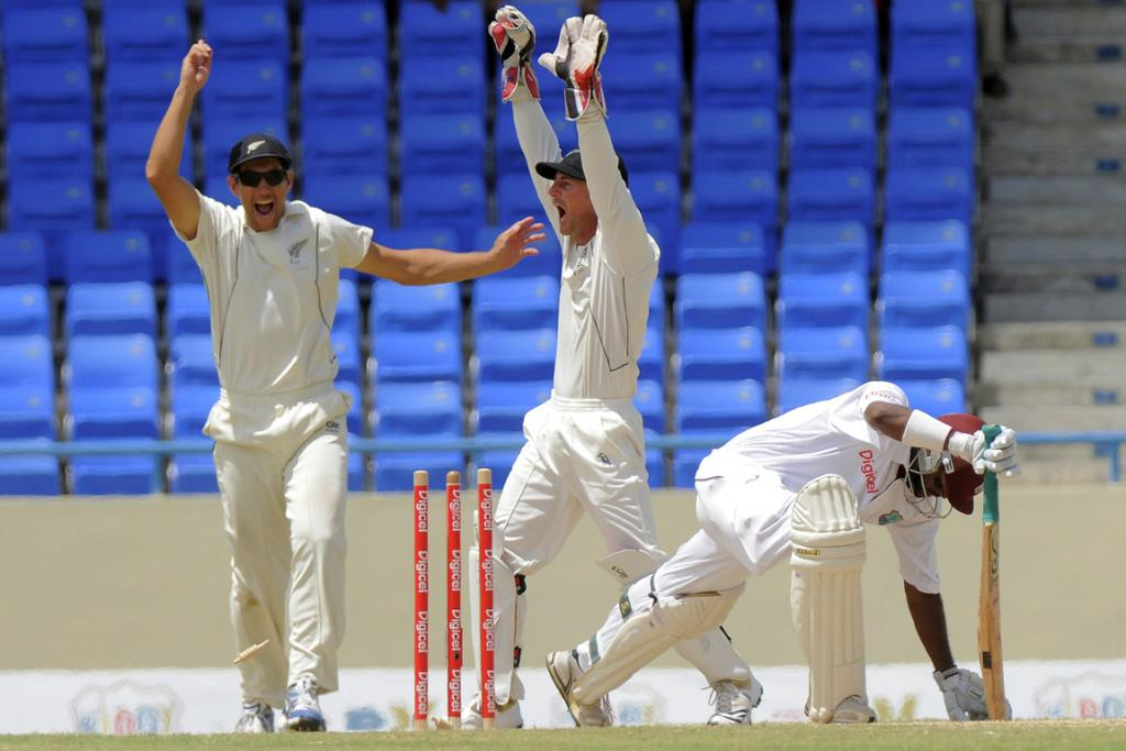 Black Caps captain Ross Taylor and wicketkeeper Kruger van Wyk appeal the wicket of Narsingh Deonarine on day four.