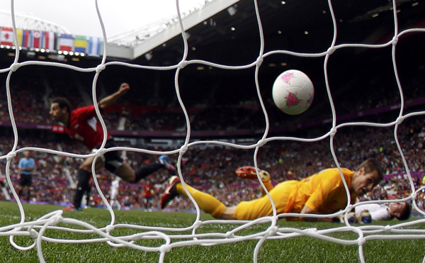 Egypt's Mohamed Salah Ghaly (L) celebrates after scoring against New Zealand's Michael O'Keeffe (front) during their men's Group C football match at the London Olympics