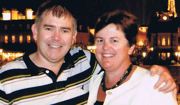 LOVING LIFE: Mark McIlroy and his wife Catherine  on one of their last overseas trips together,  at Disneyworld in Orlando, Florida, in 2010.
