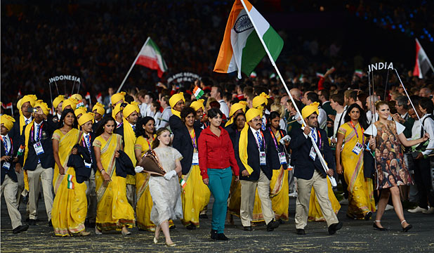 MOMENT OF FAME: Madhura Nagendra, casually dressed in red and blue, next to India's flag bearer Sushil Kumar.