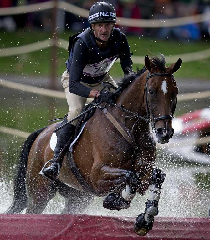 New Zealander Mark Todd, riding Campino, comes through the water jump during the cross country phase of the equestrian at Greenwich Park during the 2012 London Olympic Games.