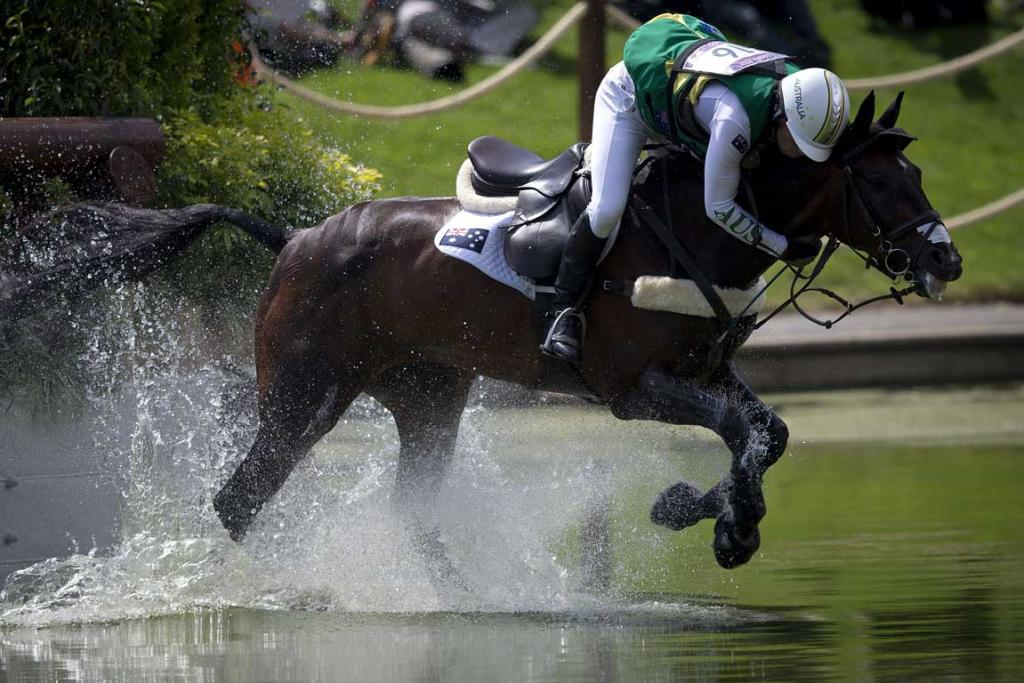 Australian Sam Griffiths, riding Happy Times, struggles through a water jump during the cross country phase of the equestrian at Greenwich Park during the 2012 London Olympic Games.