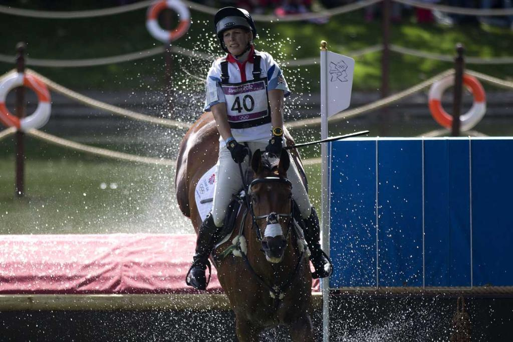 Great Britain's Zara Pillips, riding High Kingdom, comes through the water jump during the cross country phase of the equestrian at Greenwich Park during the 2012 London Olympic Games.