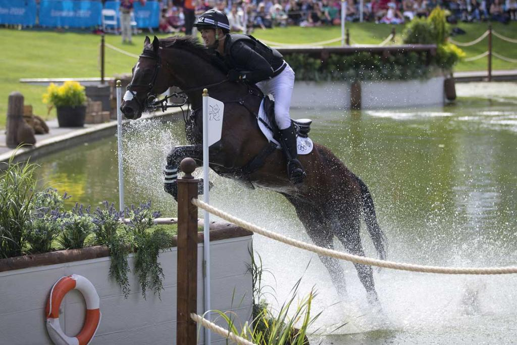 New Zealander Jonathan Paget, riding Clifton Promise, comes through the water jump during the cross country phase of the equestrian at Greenwich Park during the 2012 London Olympic Games.