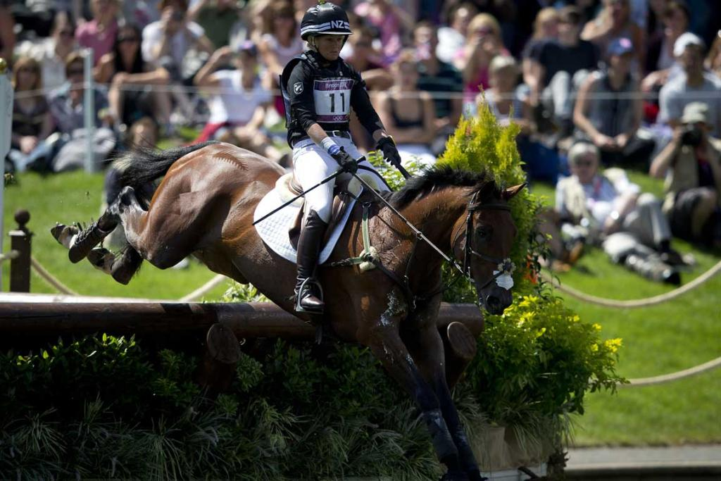New Zealander Jonelle Richards, riding Flintstar, comes through the water jump during the cross country phase of the equestrian at Greenwich Park during the 2012 London Olympic Games.