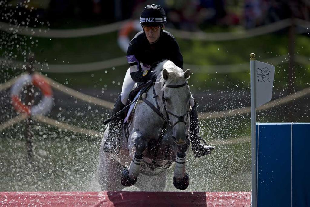 New Zealander Caroline Powell, riding Lenamore, comes through the water jump during the cross country phase of the equestrian at Greenwich Park during the 2012 London Olympic Games.