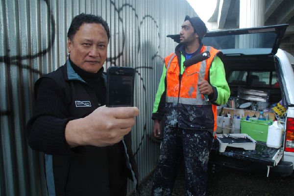 Stop tags: Hutt City Council graffiti eradication co-ordinator Delly Ranginui with SBC contractor Shahn Eru log vandalism sites into the new Stop Tags system.