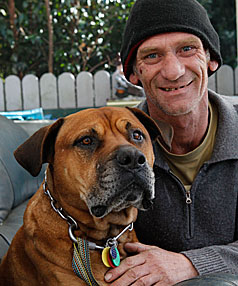 DEATH SENTENCE: Jim Tanner with Red, the bull-mastiff labrador cross that will be destroyed following a court order.