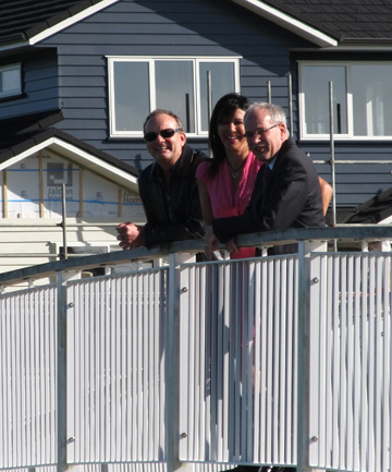 MAYOR'S TOUR: Len Brown looks over the Karaka Lakes residential area with developers Frank and Juliet Reynolds.