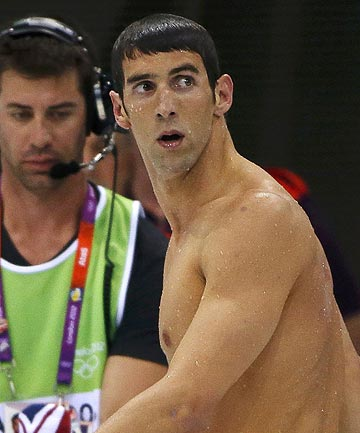 Michael Phelps leaves the pool deck after winning the silver medal in the men's 200m butterfly final during the London 2012 Olympic Games.