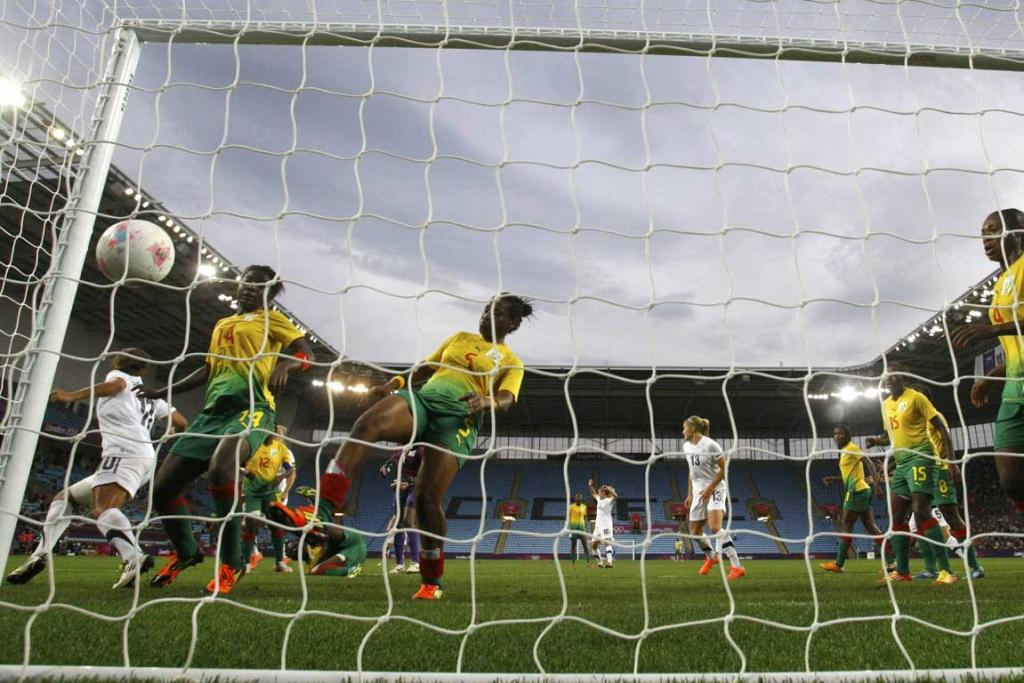 New Zealand's Rebecca Smith (unseen) heads the ball to score a goal against Cameroon during their women's football match at the City of Coventry Stadium during the London Olympics.
