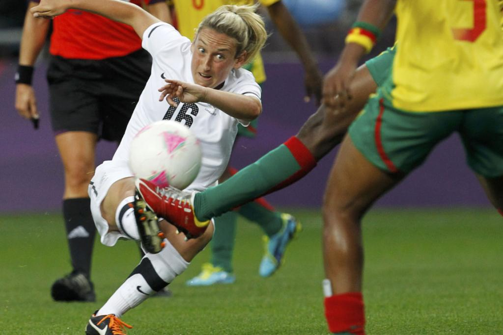 New Zealand's Annalie Longo takes a shot against Cameroon during their women's football match at the City of Coventry Stadium during the London Olympics.