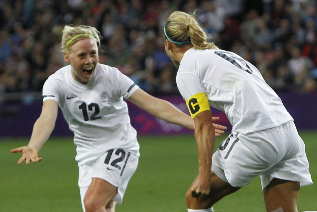 New Zealand's Rebecca Smith (right) celebrates scoring a goal against Cameroon with team mate Betsy Hasset during their women's football match at the City of Coventry Stadium during the London Olympics.