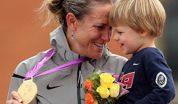 Gold medallist Kristin Armstrong celebrates with her son during the medal ceremony after winning the women's individual time trial road cycling at the London Olympics.