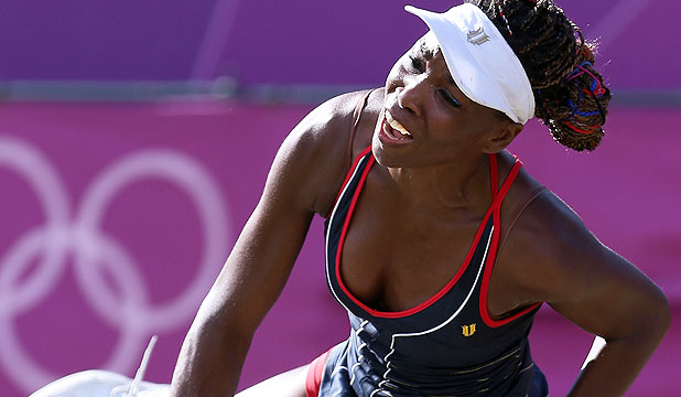 Venus Williams serves to Germany's Angelique Kerber during the American's third rounjd loss in the women's singles at the London Olympics.