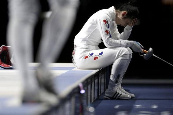 South Korea's Shin A Lam reacts after being defeated by Germany's Britta Heidemann during their women's epee individual semifinal fencing competition at the London 2012 Olympic Games.