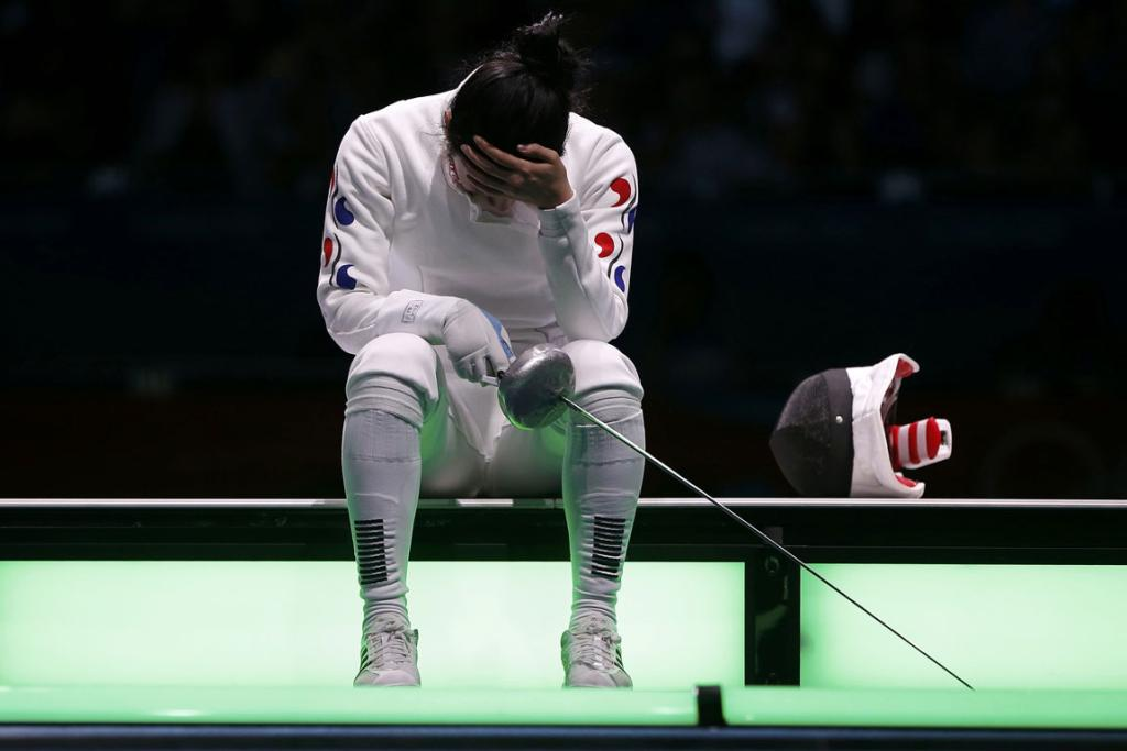 South Korea's Shin A Lam waits on the piste while an appeal is lodged after a timing malfunction cost her victory in the women's epee individual semifinal fencing competition at the London 2012 Olympic Games.