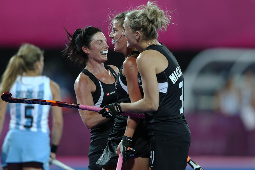 Blacks Sticks players celebrate their second half goal against Argentina at the London Olympics.
