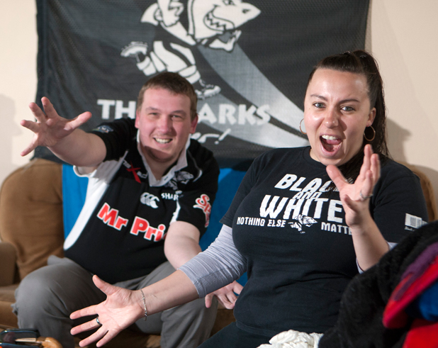 SHARK ATTACK: Sharks supporters Gustav van Rooyen, left, and Lizelle Bierman practice their cheers prior to the upcoming final at Waikato Stadium.