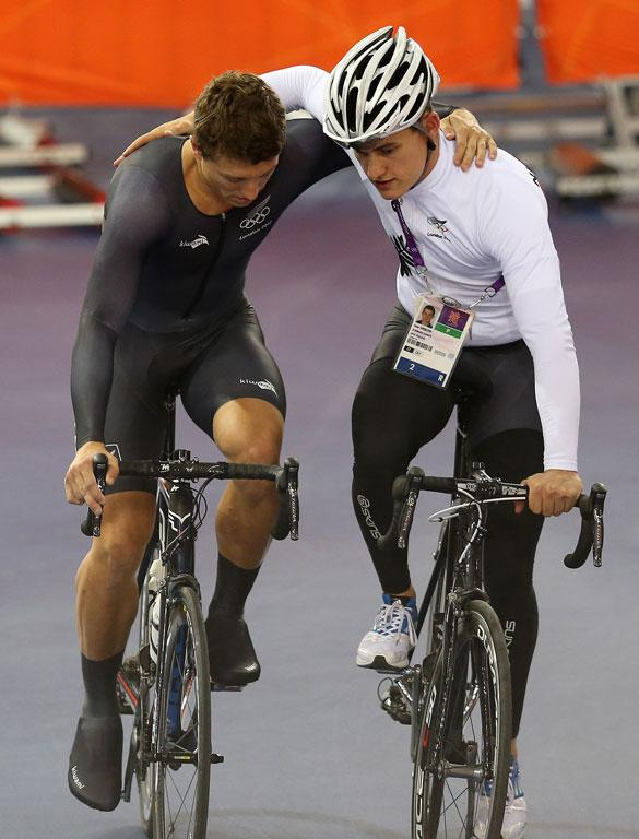 Ethan Mitchell is consoled by reserve Sam Webster after New Zealand's men's team sprint was knocked out from the qualifying.