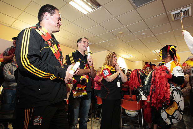 Chiefs coach Dave Rennie and player Richard Kahui judging the 'Best Dressed Fan' competition.
