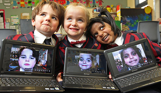 REWIRING FOR THE FUTURE: Embracing the learning opportunities of the digital world are pupils from St Mark's Church School in Wellington, Harry Simons, 6, Katia Reid, 5, and Tiya Naidoo, 5, with their notebooks.