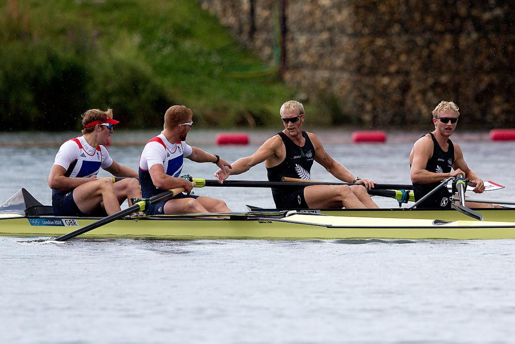 Hamish Bond and Eric Murray are congratulated by the Great Britain rowers after winning gold in the men's pair at Eton Dorney.
