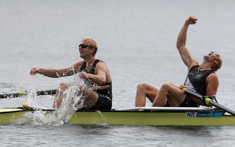 Hamish Bond and Eric Murray celebrate after winning gold in the men's pair at Eton Dorney.