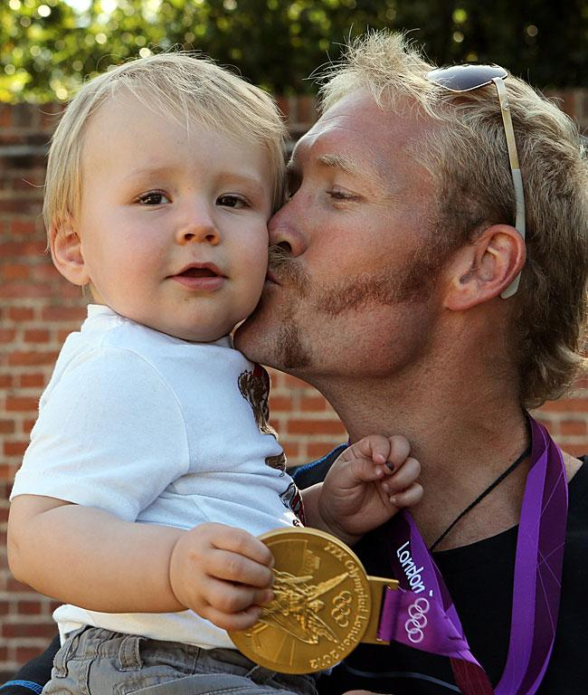 Eric Murray with his son Zac after winning the gold.