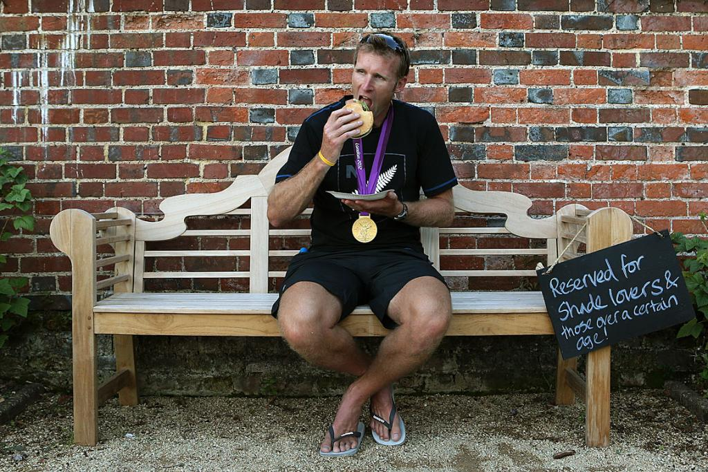 Mahe Drysdale relaxes with a well earned burger after scoring the rowing gold.