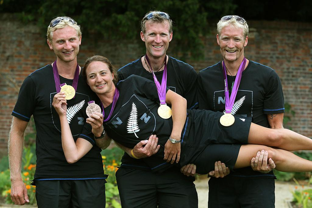 Gold medalists from left: Eric Murray, Mahe Drysdale and Hamish Bond carry bronze medalist Juliette Haigh near Eton Dorney, London.